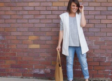 White vest outfit with ripped jeans and neutral accessories