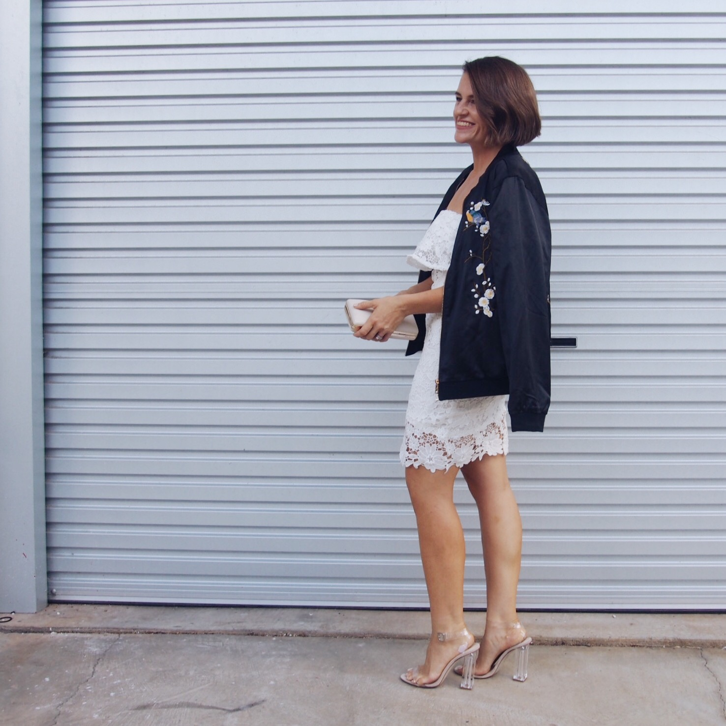 embroidered bomber jacket with white lace dress outfit
