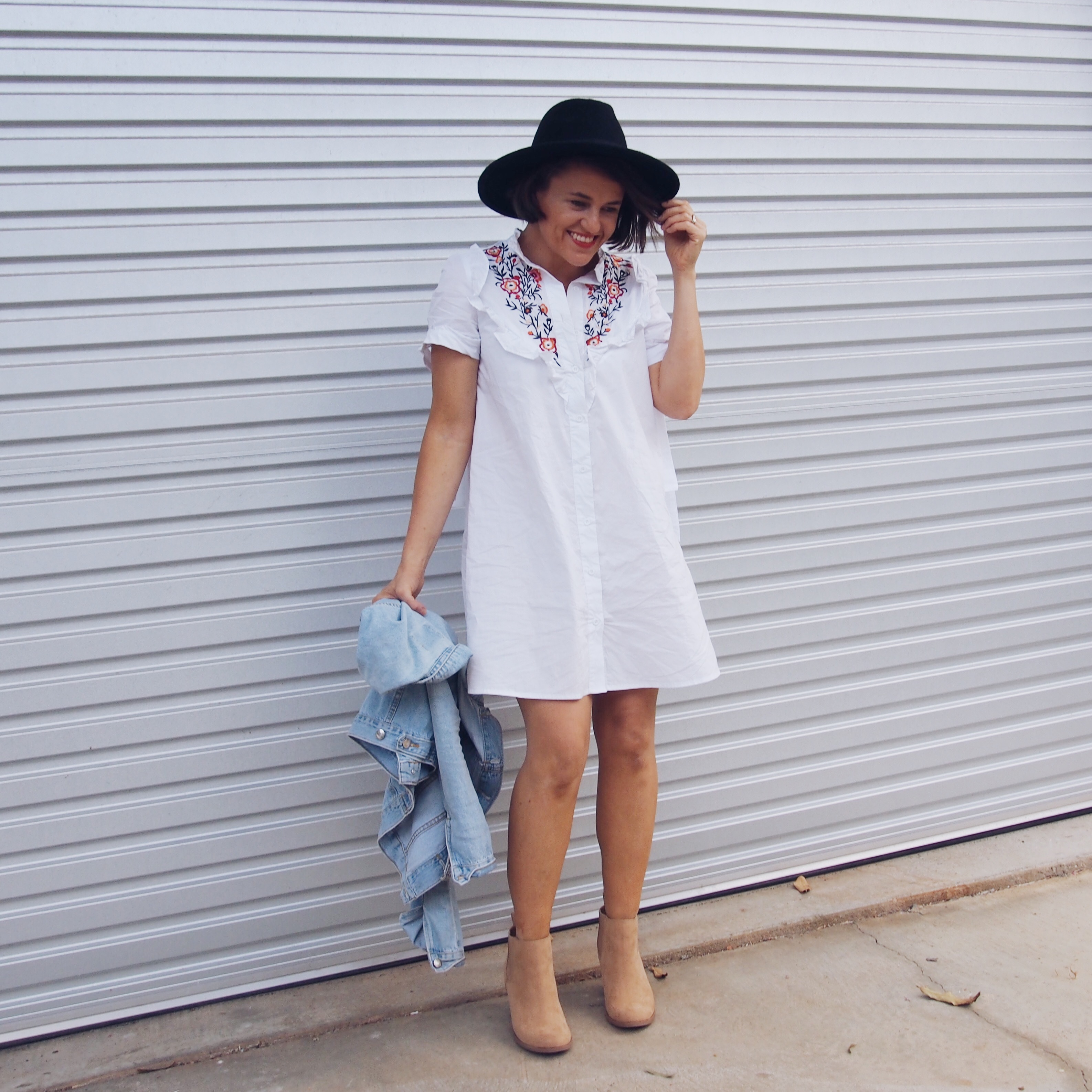 embroidered shirt dress and boots outfit