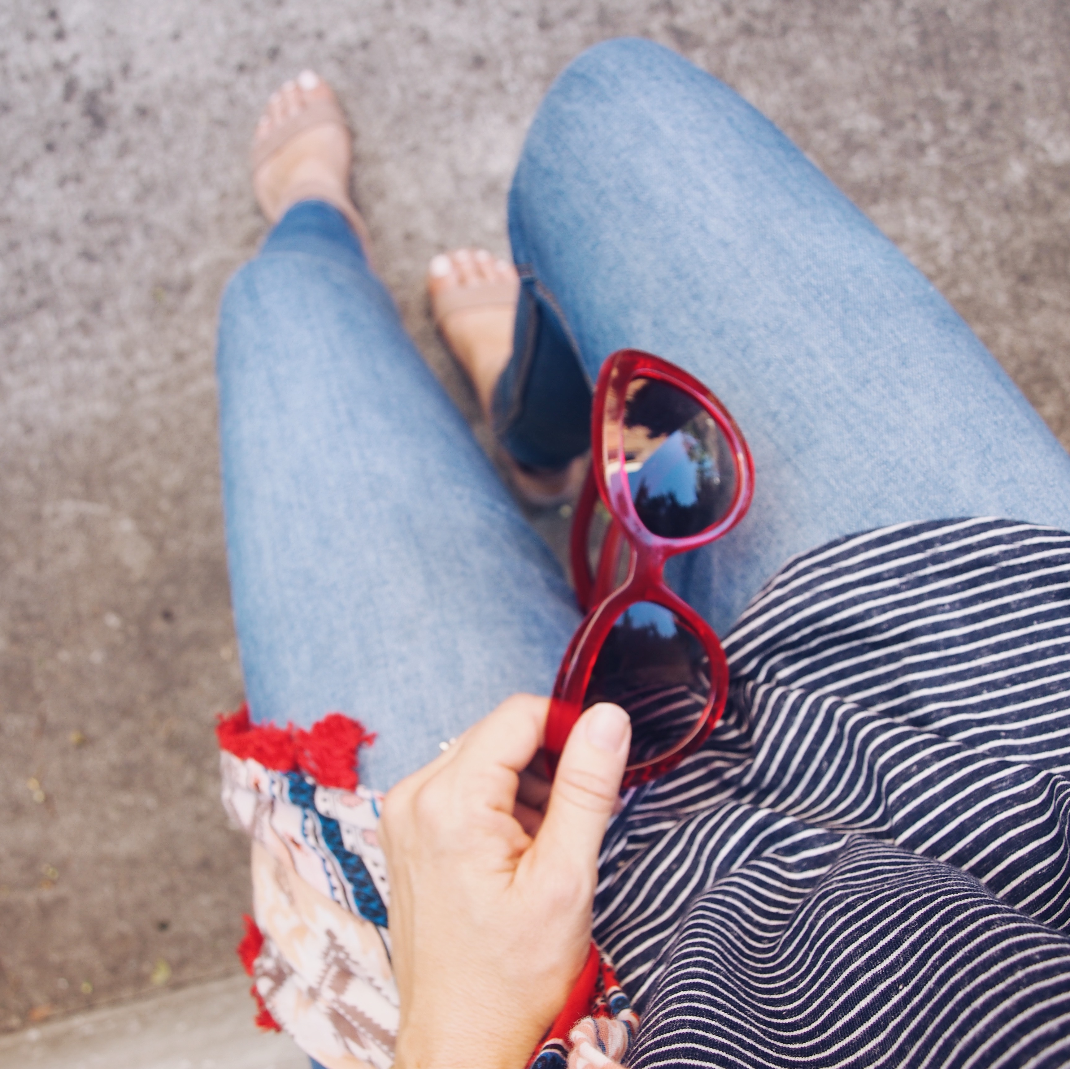 red sunnies, jeans and stripe tee outfit