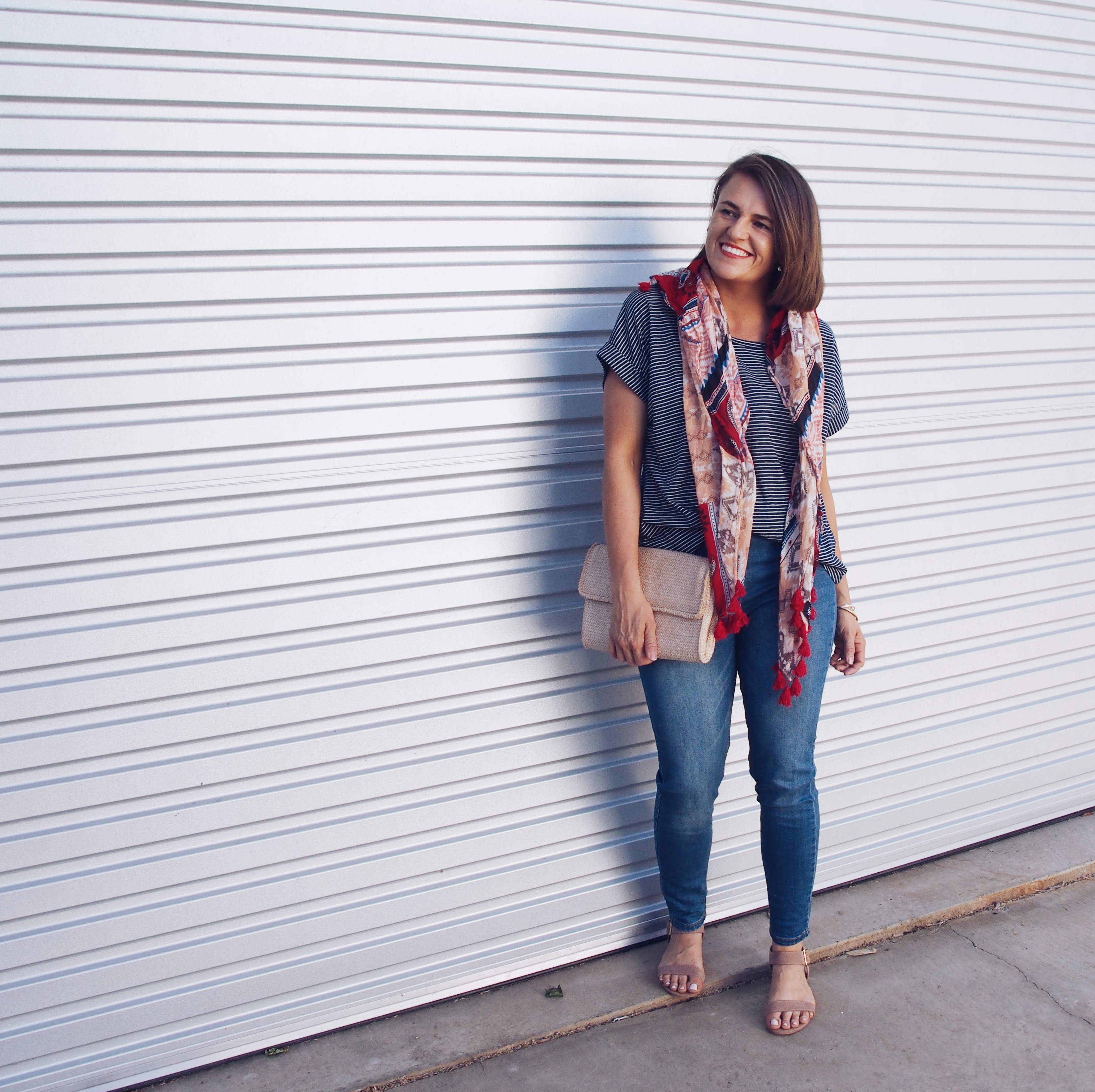 scarf and stripe top with jeans outfit idea